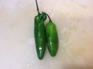 Serrano chilies, one freak, one not