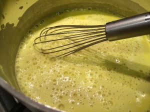 Whisking kadhi on stovetop