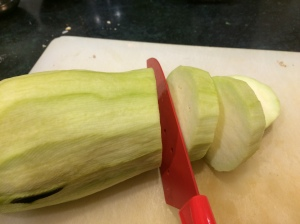 Slicing eggplant, half inch thick